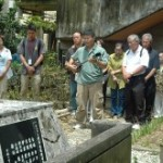 Okinawan Americans come from Hawaii to play the sanshin at a requiem held at the Miyamori Elementary School Memorial