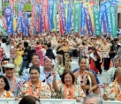 6000 people come together from across the globe, enjoy samba and hula in a parade in Kokusai Street
