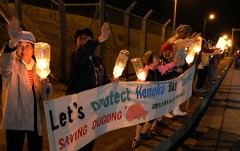 Peace Candle service held at Henoko on Christmas Eve