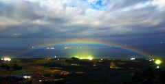 Night rainbow said to invite happiness photographed on Ishigaki Island