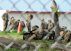 U.S. military personnel seen training with rifles in Camp Kinser close to Route 58