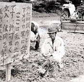 Anti-war landowner Zenyu Shimabukuro refuses to provide his land for U.S. military use
