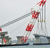 Giant crane ship lifts down a 140-meter long and 1300-ton box girder onto the Irabu-Ohashi Bridge