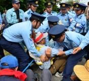 Citizen group sit-in block gates to U.S. Futenma base