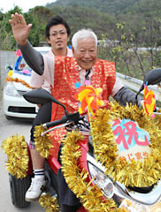 Ninety-six year-old motorcycle rider parades in celebration