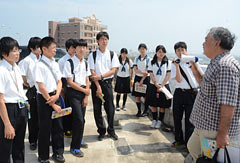 Citizens of Okinawa City guide students from main islands of Japan around Koza