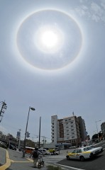 Ring of light surrounding the sun appears in sky