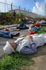 "Nine years since U.S. helicopter crash onto Okinawa International University: Protesters stage a ""die-in rally"" in front of Marine base"