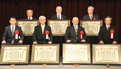 Seven karate masters receive service awards