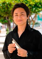 Okinawan player comes second in World Harmonica Festival