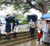 High school students guide explaining Japanese schoolgirls who worked for the Imperial Japanese Army during Battle of Okinawa