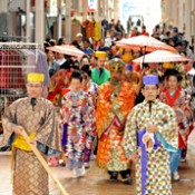 People in traditional Ryukyuan costume parade for Doll's Festival