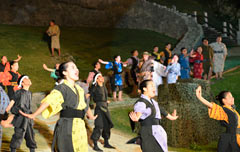 Students in Uruma perform the modern kumiodori play at the world heritage site Katsuren Castle