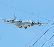 A  KC-130 aerial refuelling tanker stationed at Iwakuni base trains at Futenma Air Station
