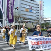 Buddhist monks and U.S.veterans take part in protest march against the construction of a new U.S. military base in Henoko and helipads in Takae