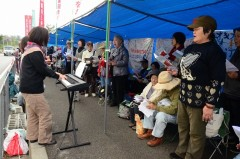 Sit-in protesters sing gospel to oppose the construction of a new U.S military base in Henoko
