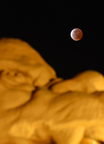 Reddish-brown moon appears during total eclipse