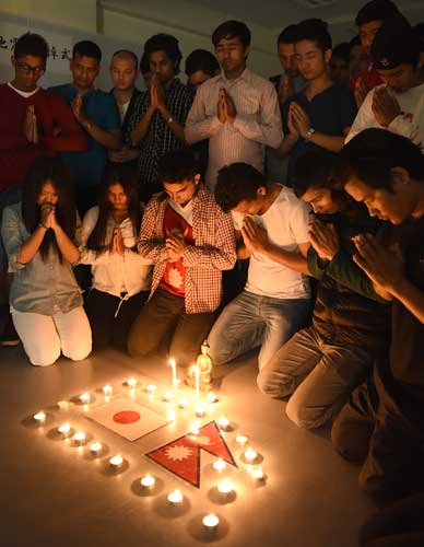 Nepalese students hold memorial service to pray for homeland