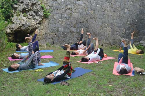 Yoga practice at ruins of Chinen Castle