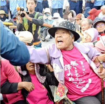 Eighty-six-year-old Fumiko Shimabukuro takes a stand in front of Camp Schwab