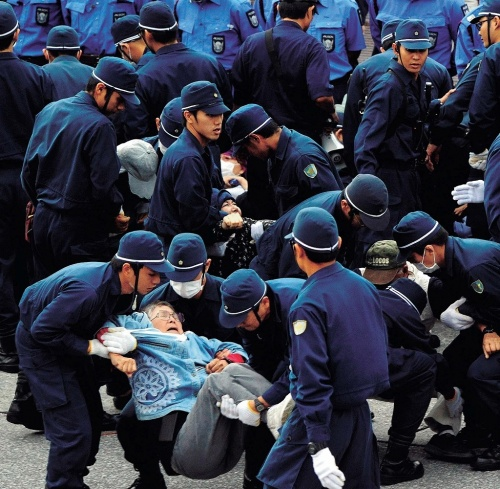 Tokyo riot police join security at Camp Schwab; protester arrested in scuffle