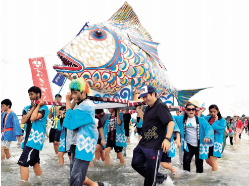 Residents wish for safe navigation and a good season's fishing at Sanguwacha in Uruma