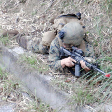 Citizens see US soldier holding gun along roadside in Kunigami