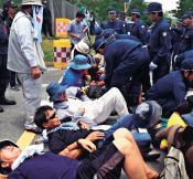 Tensions between protesters and riot police mount over construction of U.S. Marine Corps helipads in Takae