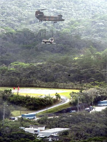 JSDF aircraft carry heavy equipment over prefectural road for U.S. helipad construction