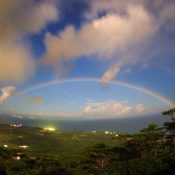 Rainbow in night sky drawing arch of happiness captured in Ishigaki