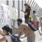 Young attendees to the 6th Worldwide Uchinanchu Festival visit and study Henoko and Takae