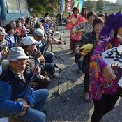 Sanshin Day: citizens perform traditional music and dance in front of Henoko gate, as protesters resolve to use the power of culture to stop new US base