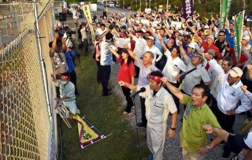 300 people protest to stop US military helicopter training involving the hanging of vehicles