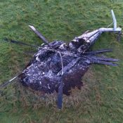 Burned-out U.S. Marine CH-53E helicopter casts a disturbing image after a forced landing in Takae