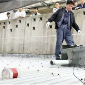Canister believed to be from a US helicopter lands on a nursery school in Ginowan