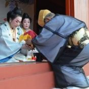 Praying for health and longevity, the New Year's first water is offered in traditional ceremony at Shuri Castle