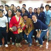 JICA volunteer Lima Tokumori teaches peace lesson about Okinawa to La Unión students in Peru
