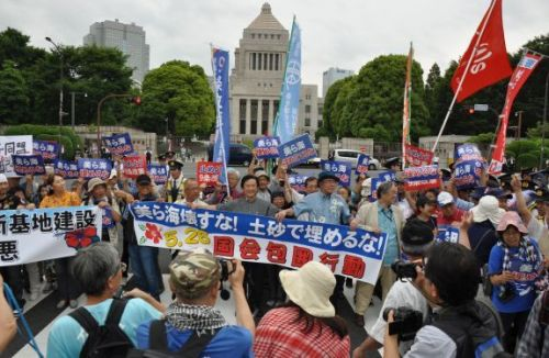 Ten thousand people encircle Japan's National Diet to protest land reclamation work in Henoko