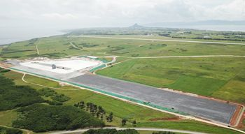 Expansion work on airstrip simulating ship's deck proceeding at Ie Jima Auxiliary Airfield