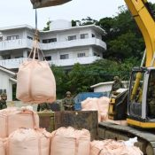 Disrupting lives, the bitter legacy of war resurfaces during the disposal of undetonated ordinance in a residential neighborhood in Naha