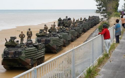 U.S. military amphibious vehicles cross highway in Ginoza, stopping traffic