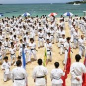 Stunning! 1,000 Karate-ka perform a martial arts demonstration for peace against the backdrop of the blue Okinawa Sea