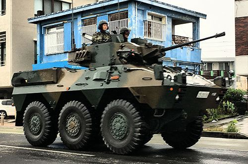 GSDF armored vehicle seen driving along National Route 58 with machine gun uncovered
