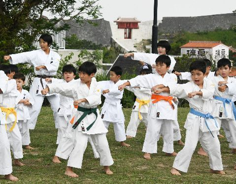 Six Dojos come together to perform Karate demonstration praying for the Shuri Castle reconstruction and to give courage to the region