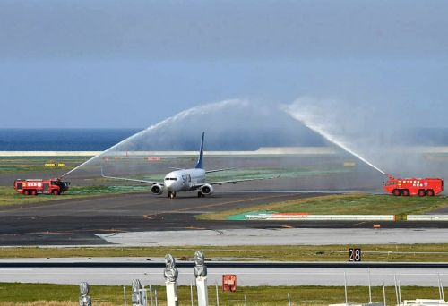 Naha Airport's Runway No. 2 open for use, first flight to land greeted by firehose arch