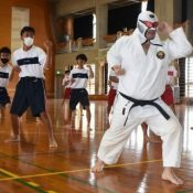 "With a fighting shout accompanied with Music, Bunshiro Nagamine leads ""Radio Karate"" at Yaesekotoshien School"