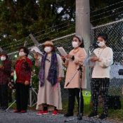 Okinawa Christians sing outside U.S. military base wishing for a peaceful world without fence