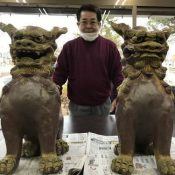 "Okinawan man observation deck for a pair of Shisa in front of his house on the Fukushima coast ""for the soul of restoration"""