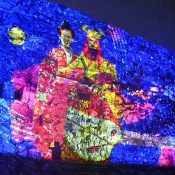 Hokuzan king makes an appearance at Nakijin Castle at night! The world heritage site's castle wall get a vibrant light-up display