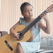 Japan's best guitarist is a second grader from Okinawa—father helps daughter achieve her dreams
